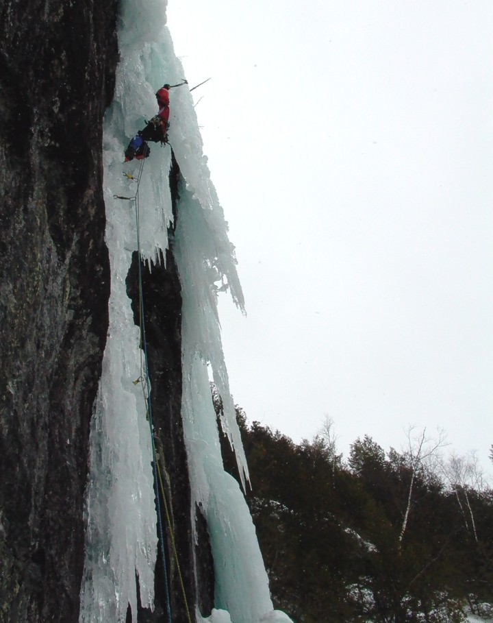 At the top, the ice overhangs; the route finishes by mounting the free-hanging pillar to the right