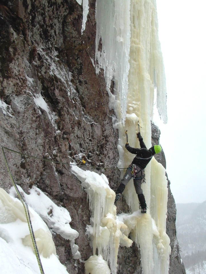 Joe gets established after the traverse and prepares to climb the overhanging ice above