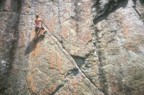 At the end of the diagonal crack; a couple of pieces here protect the crux left traverse