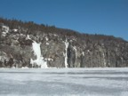 Approaching the Palisades across the ice of Lake Champlain from the Vermont side