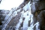 Joe climbs the steeper ice; the crux is just above