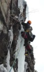 The free-hanging pillar is the crux of this route, although the unprotected climbing above is engaging