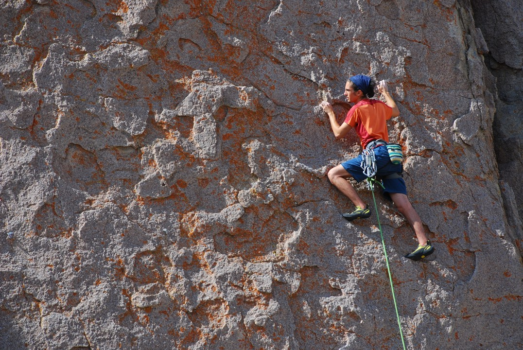 Easy face climbing on plates with cool orange lichen
