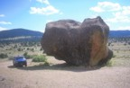 Tommy's truck parked next to a giant boulder