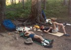 Tracy and Jim relaxing after a day of hiking; notice the paper towels, Sierra Club cups, and prototype Marmot bivy sacks
