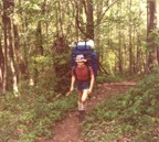 Tracy carrying a monster load in a Trailwise frame pack, somewhere in the deep south