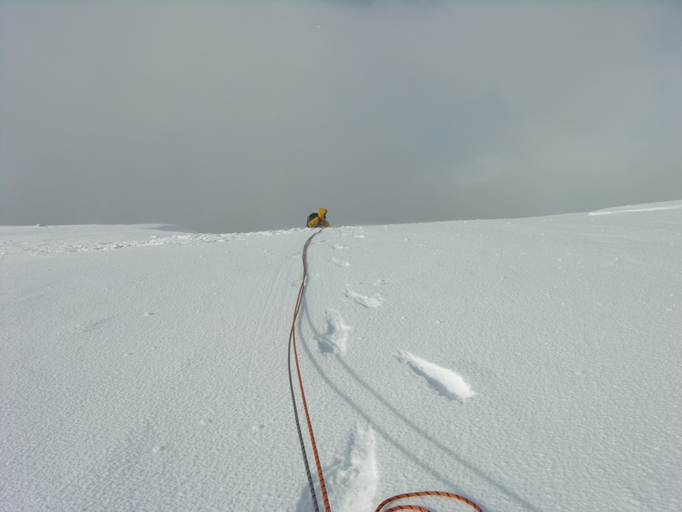 Breaking through the cornice onto the flat summit plateau