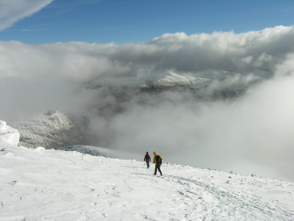 Descending off the summit through intermetent white out