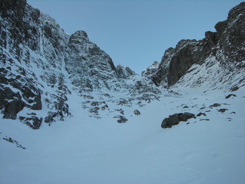 A view of Point Five Gully on the approach. The route follows the obvious deep gully on the left.