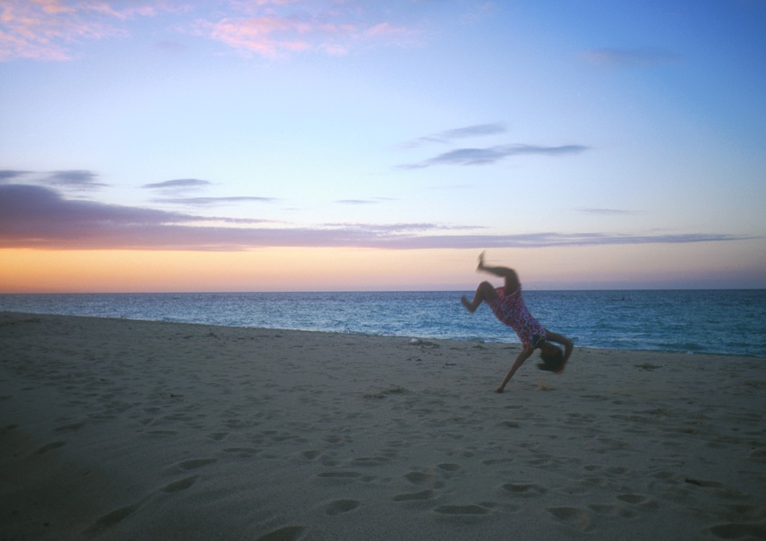 Lucie being blown by the wind at sunset (she's actually doing a handspring)