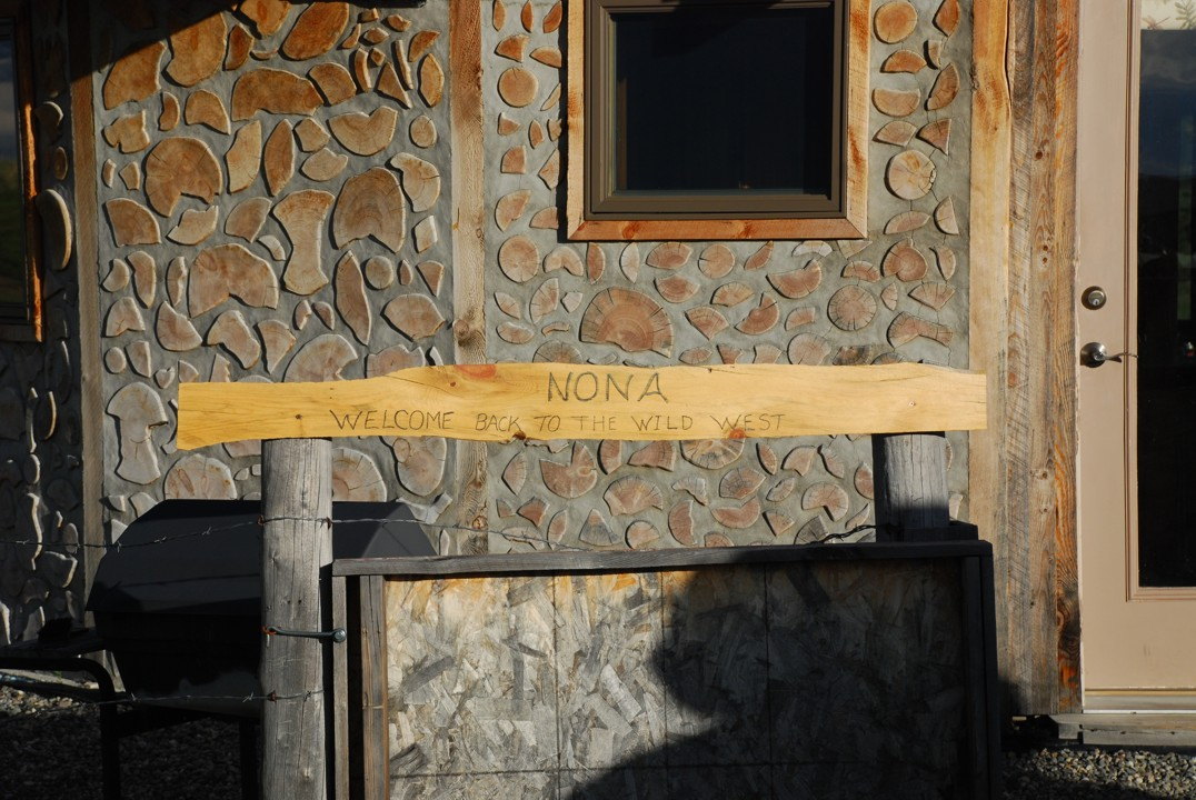 Entry way sign welcoming Nona, his wife