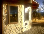 "The ""Mother Ship"" is a cordwood masonery house made using wood cut from forest service land in East Rosebud Canyon"