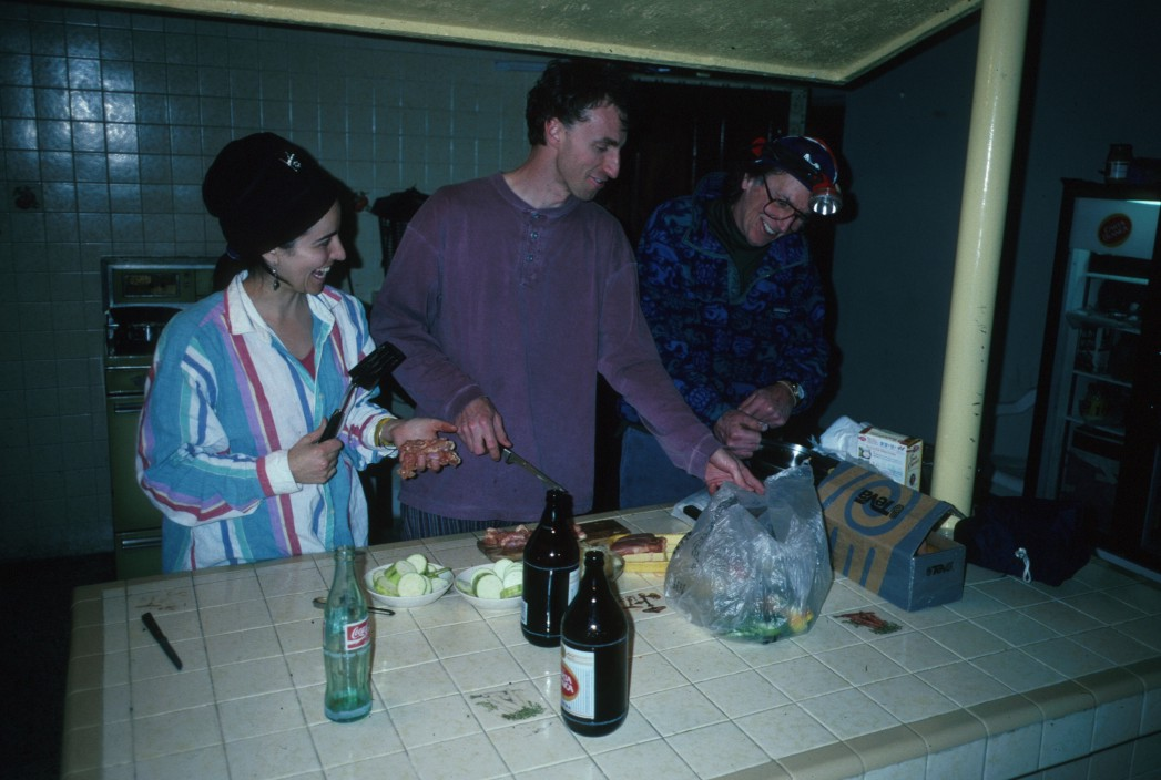 Lucie, Simon, and John cooking