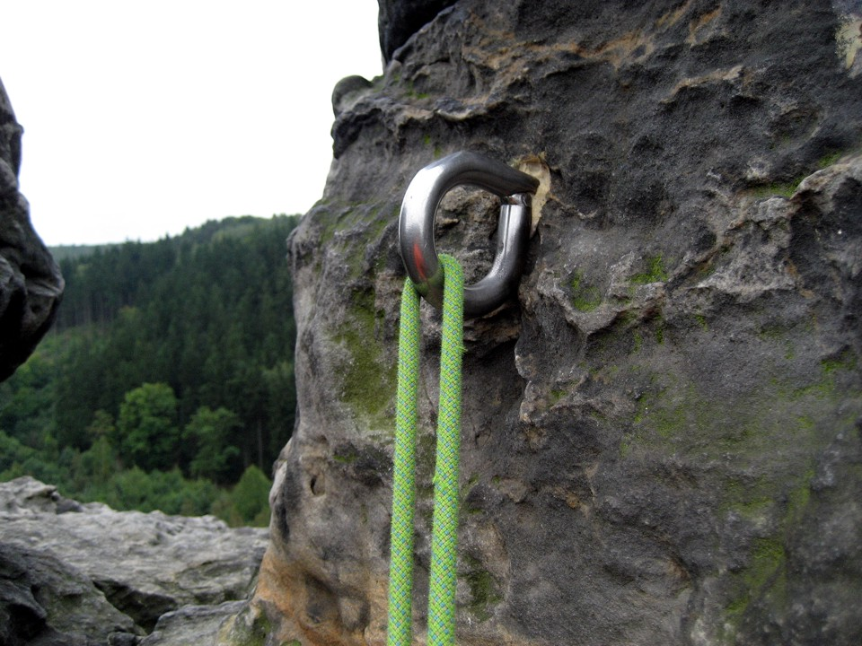 Giant rappel rings; the flat spot on the top is so that you can clip a caribiner to it