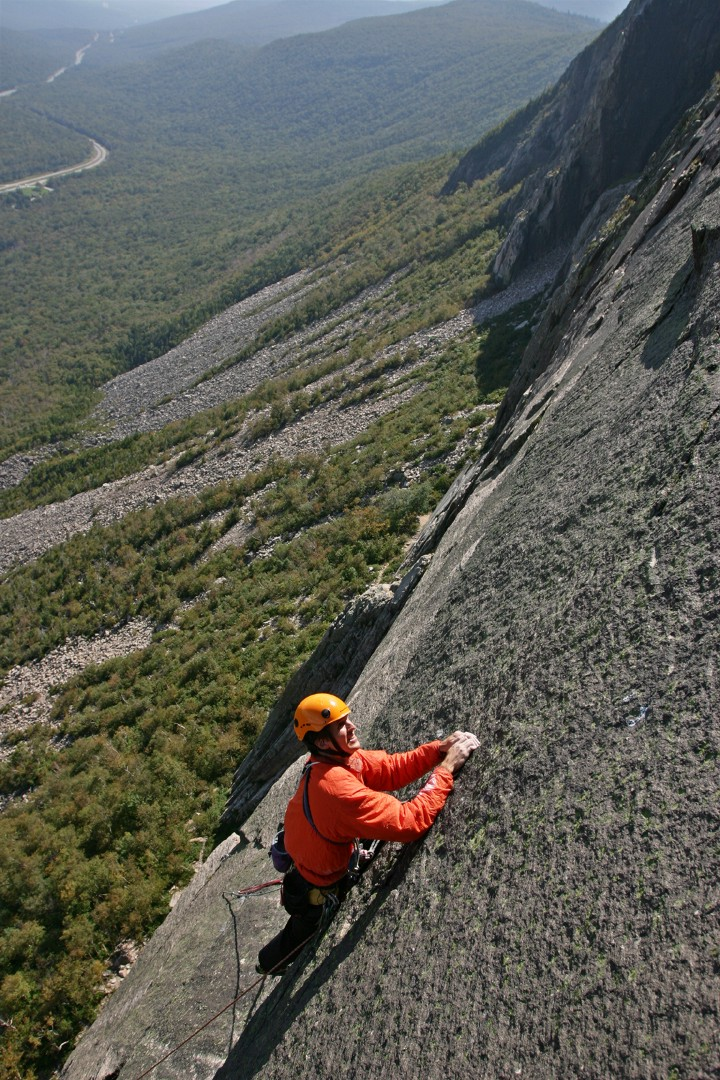 Climbing the slab below the overlap on the 5th pitch