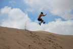 Big jump with plume of sand