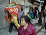 Lion dancer in the streets of Guangzhou