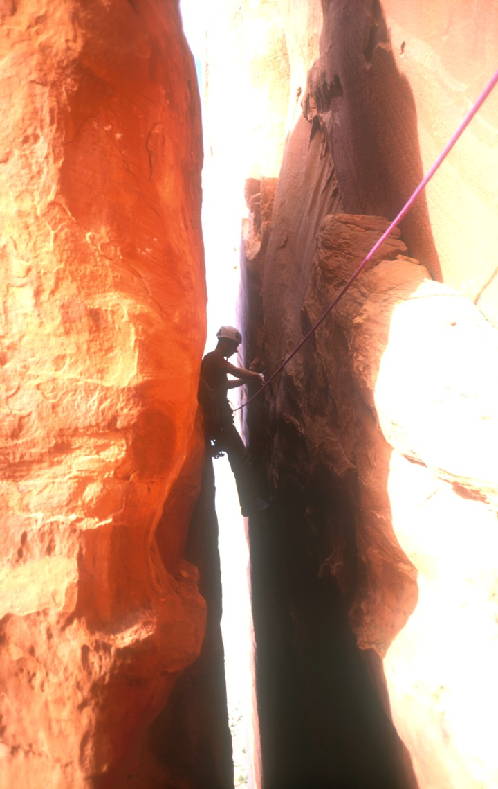 The third pitch traverses left in a chimney to an off-width crack in the main face