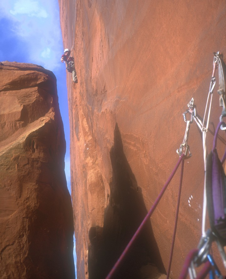 Getting established in the off-width crack above the chimney on the third pitch