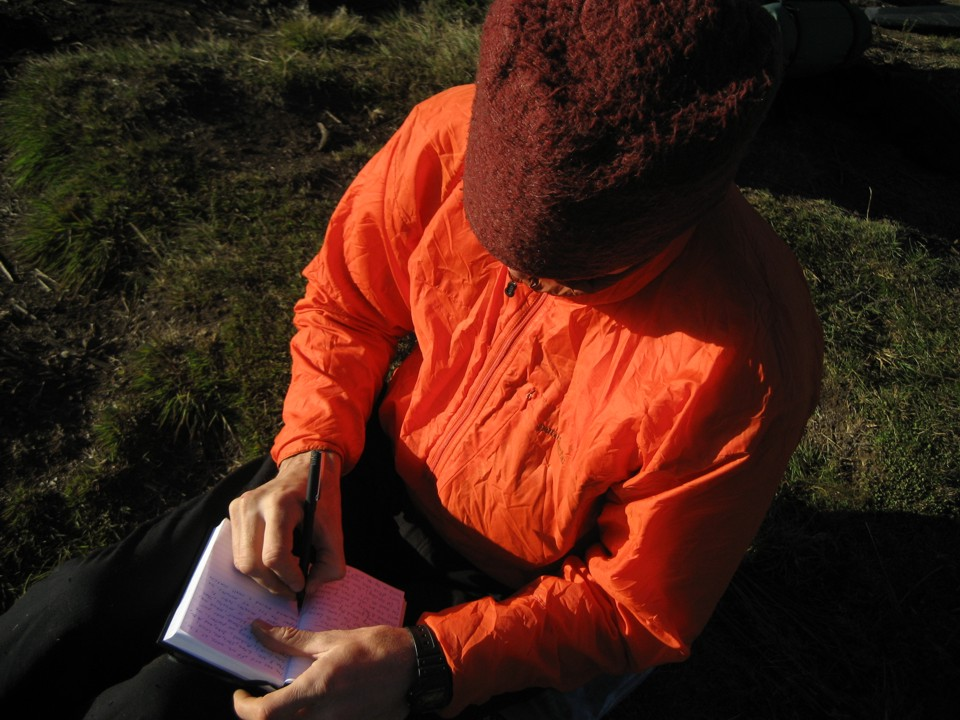 Writing in the journal at camp at the start of the approach