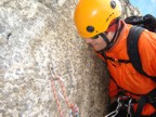 Examining the single-point rappel anchor; looks good