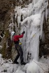 Climbing the first curtain; the ice barely accepts stubbie screws