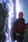 Nikos at the second belay in an ice cave