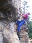 Tommy climbing an overhanging, juggy route