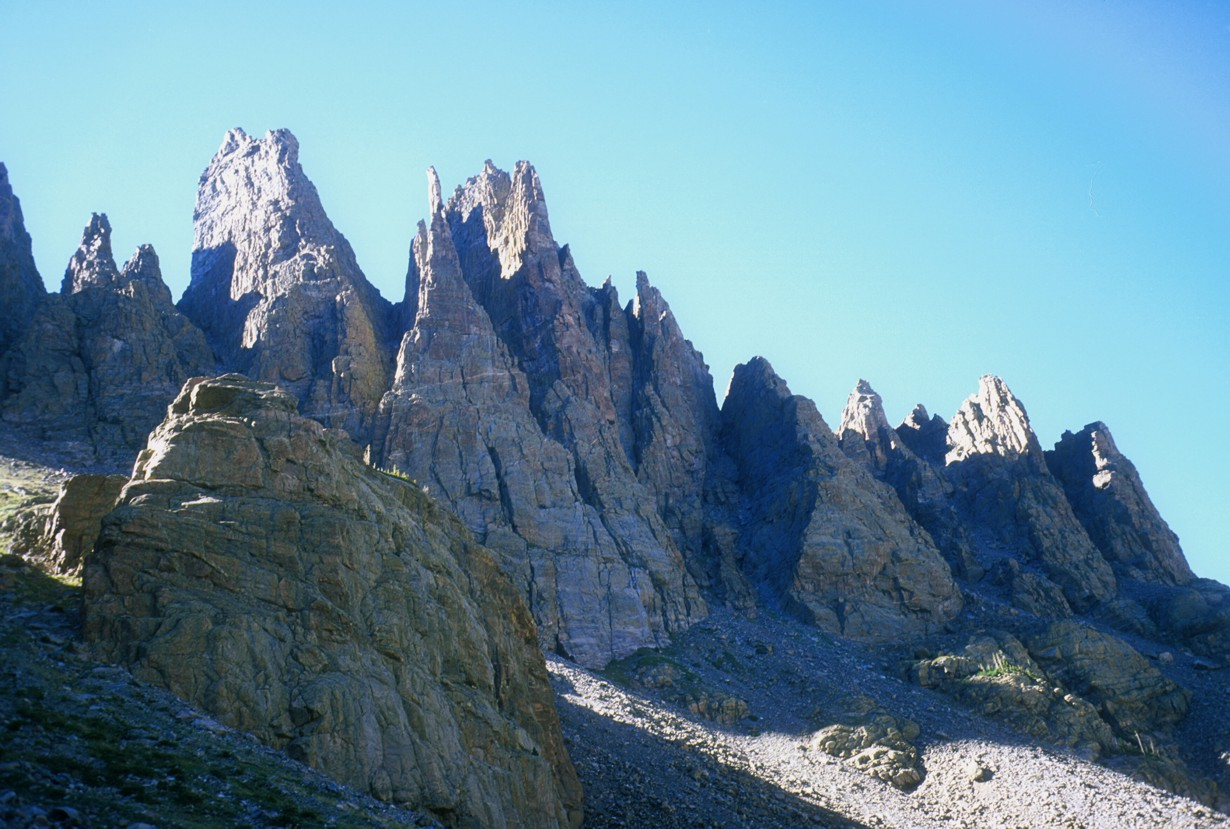 Cathedral Spires at dusk; the Petit Grepon is the thin needle-like summit above the large triangular face