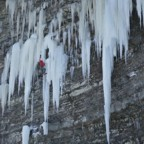 From the top of the ice column, Bones mounts the ice and climbs into a small ice cave to rest