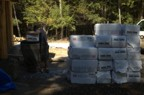 Bales of cellulose await loading into the hopper
