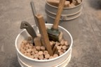 Bucket of dowels used hold the joints together