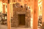 Stonework around the wood storage cubby