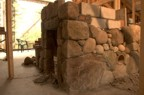 Stonework around the air intake and wood storage cubby