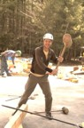 Colin messing around with the giant hammer, Kevin in the background