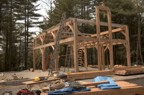 The timber frame without the rafters and ridge pole