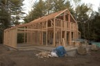 The completed timber frame is surrounded by stick-built 2x6 walls
