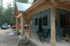 The completed front porch -- 2x4 T&G white cedar floor, 2x6 T&G white cedar ceiling, cedar posts, and pine timber framing