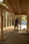 Jim standing on the back porch before the floor was installed
