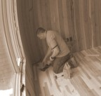 Johnny finishes the final corner of flooring in the bedroom