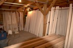 Maple board drying in the barn; drying racks are built from ropes run across the width of the barn
