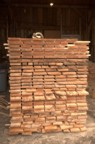 A pile of rough-sawn maple stacked in the barn during milling