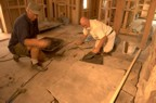Mark and his brother Phil cement the floor stones into position