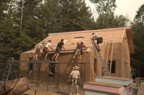 "A large crew is required to lift the 10"" stress skin panels onto the roof"