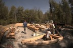 Bits of the timber frame are assembled on the ground before being raised