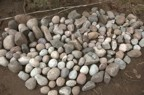 The collection of round stones gathered from the river for use in the chimney