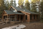 The new roof from the northwest with cutouts for the kitchen exhaust, boiler, and septic vent
