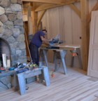 Schelly cuts flooring on the chop saw