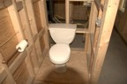 A temporary toilet is installed for the crew