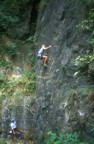 Climbing through the crux slab using small finger pockets